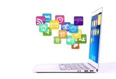 Computadora portátil con los iconos coloridos de la aplicación. Fotografía de archivo