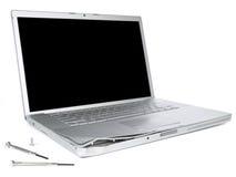 Computadora portátil dañada Fotografía de archivo libre de regalías