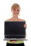 Computadora portátil de la explotación agrícola de la muchacha Foto de archivo libre de regalías
