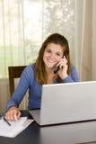 Computadora portátil de la muchacha Imagenes de archivo
