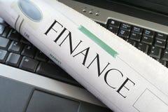 Computadora portátil de las finanzas Fotografía de archivo