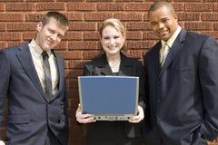 Computadora portátil de las personas del asunto Imágenes de archivo libres de regalías