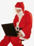 Computadora portátil de Santas imagen de archivo libre de regalías