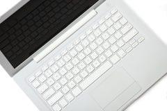 Computadora portátil del blanco de la elegancia. Apple MacBook. Imagenes de archivo