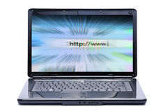 Computadora portátil e Internet Imagen de archivo libre de regalías