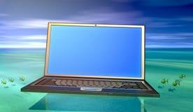 Computadora portátil en agua Foto de archivo libre de regalías