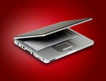 Computadora portátil en fondo rojo Imágenes de archivo libres de regalías