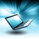 Computadora portátil flotante azul del ordenador con resplandor Fotos de archivo