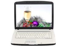 Computadora portátil. La visualización - foto de la Navidad. imagen de archivo