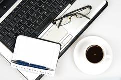 Computadora portátil y agenda imagen de archivo