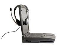 Computadora portátil y auriculares Imagen de archivo libre de regalías