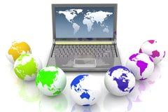Computadora portátil y globos de todos los colores del arco iris Foto de archivo