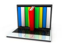 Computadora portátil y libros