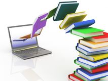 Computadora portátil y libros Foto de archivo libre de regalías