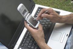 Computadora portátil y móvil Fotos de archivo libres de regalías