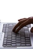 Computadora portátil y mano Fotografía de archivo