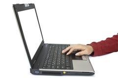 Computadora portátil y mano Imagen de archivo