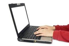 Computadora portátil y manos Fotografía de archivo