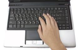 Computadora portátil y manos Imágenes de archivo libres de regalías