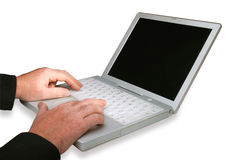 Computadora portátil y manos Fotografía de archivo libre de regalías
