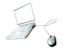Computadora portátil y ratón Imágenes de archivo libres de regalías