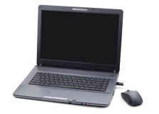 Computadora portátil y su ratón Fotografía de archivo libre de regalías