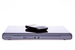 Computadora portátil y teléfono celular móvil Fotografía de archivo libre de regalías