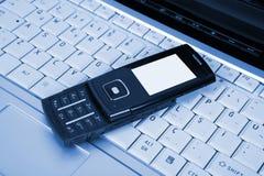 Computadora portátil y teléfono móvil Foto de archivo libre de regalías