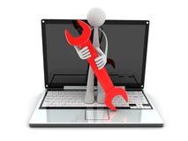 Computadora portátil y trabajador Imágenes de archivo libres de regalías