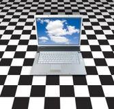 Computadora portátil en tablero Fotos de archivo libres de regalías