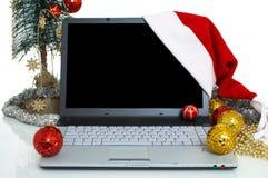 Computadora portátil para la Navidad Fotografía de archivo