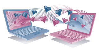 Computadoras portátiles en amor Imagen de archivo libre de regalías