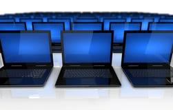 Computadoras portátiles por todas partes Foto de archivo
