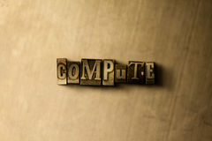 COMPUTE - close-up of grungy vintage typeset word on metal backdrop Royalty Free Stock Images