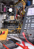 Computer. In Repair, Multimeter,Oscilloscope and Mother Boar Stock Images