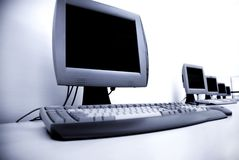 Computer. A few computers in a class room over white Royalty Free Stock Photo