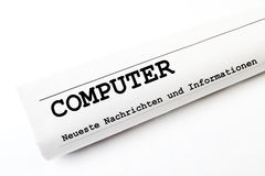 Computer. Newspaper on white background stock photo