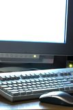 Computer. The computer mouse, the keyboard, the monitor on a background Royalty Free Stock Images