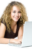 On the Computer. A beautiful young women on a laptop computer Royalty Free Stock Photos