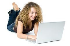 On the Computer. A beautiful young women on a laptop computer Royalty Free Stock Images