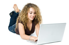 On the Computer. A beautiful young women on a laptop computer Stock Images
