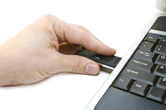 Computer. The man usb flashdrive connects to the computer royalty free stock photos