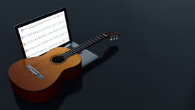 Computer with acoustic guitar Royalty Free Stock Photography