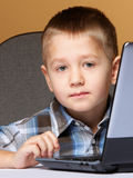 Computer addiction child with laptop computer Royalty Free Stock Images
