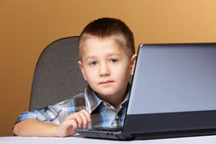 Computer addiction child with laptop computer Stock Photos