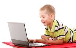 Computer addiction child with laptop notebook Stock Photography