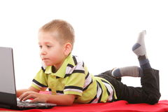 Computer addiction child with laptop notebook Royalty Free Stock Photo