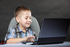 Computer addiction child with laptop notebook Royalty Free Stock Photos