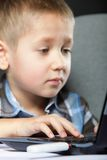 Computer addiction child with laptop notebook Royalty Free Stock Images