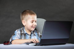 Computer addiction child with laptop notebook Stock Photo